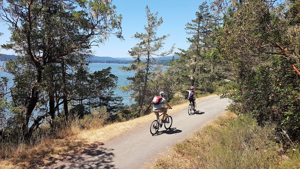 Riding the spectacular Gallopping Goose Trail near Sooke, Vancouver Island