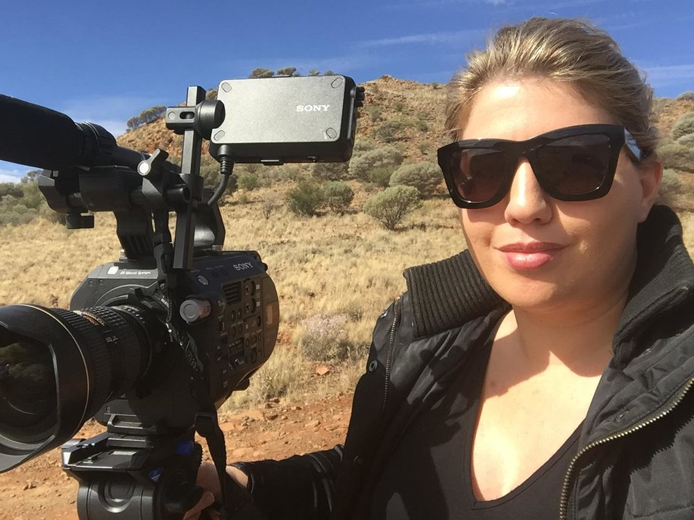 """Kate next to Mt Leonora, while producing a multimedia exhibition titled """"Gwalia's Gold - its people and places"""", which was a finalist in the Interpretation category of the WA Heritage Awards."""