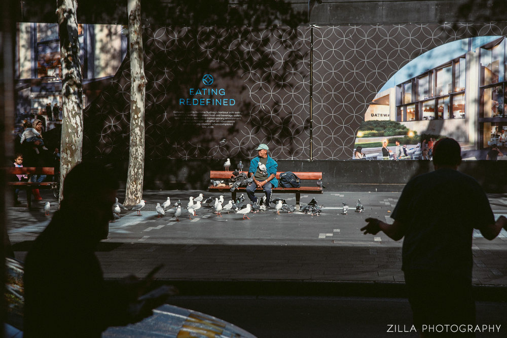 feeding the pidgeons - caught while wandering the streets of sydney, australia