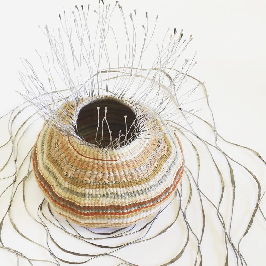 Seep,  2016. Aluminium wire, plant dyed wool, silk and hemp. 24 (h) x 52 x 50 cm.