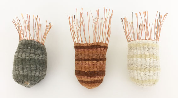 Hidden Gold,  2016. Copper, silver and gold wire, plant-dyed wool, silk and hemp. Approx. 14 x 6 x 6 cm each