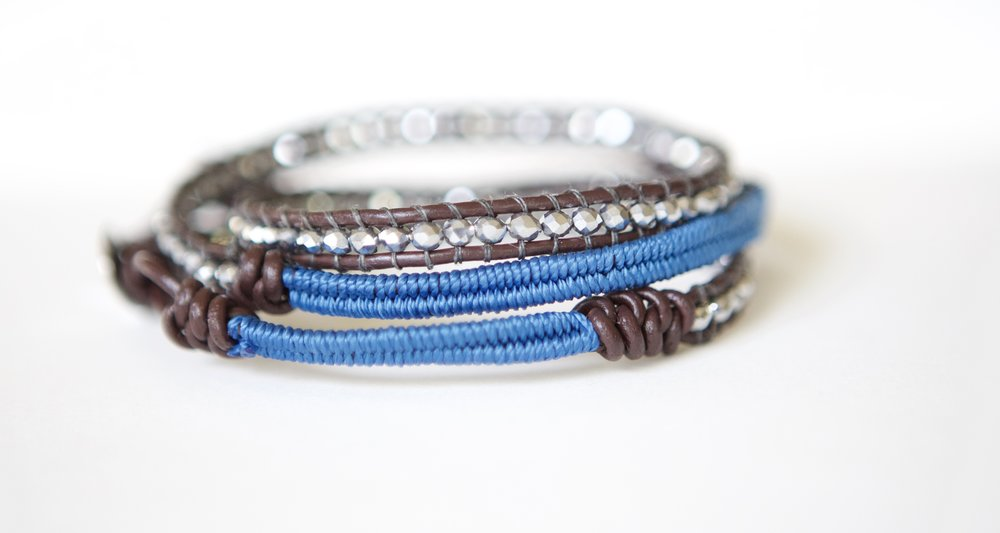 Beaded with crystal, leather and blue waxed cord.