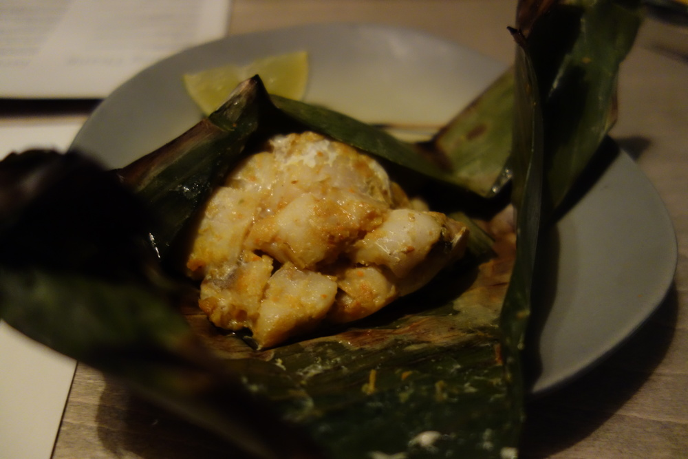 Banana leaf wrapped fish.