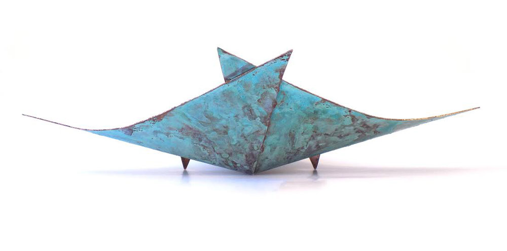 The Stingray, a fruit platter created using one sheet of copper, with patina applied to the underside