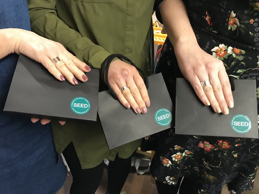 Three happy recipients showing off their rings and special goody bags.