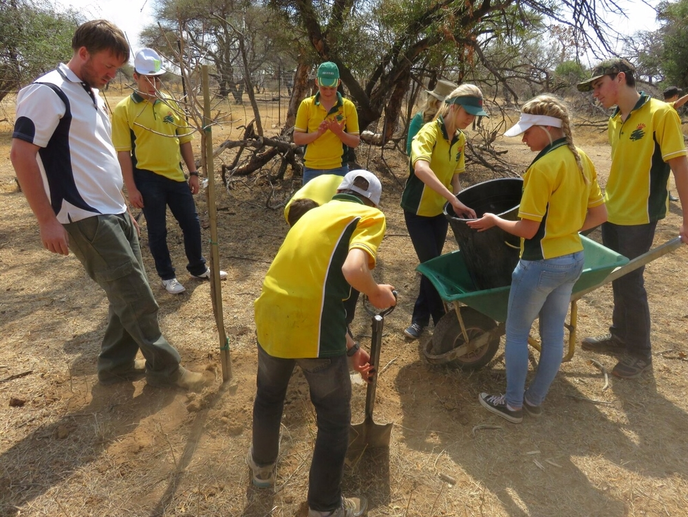 Michael and students from Warmbaths High School plant indigenous Marula trees to counter the effects of elephants on the bush.