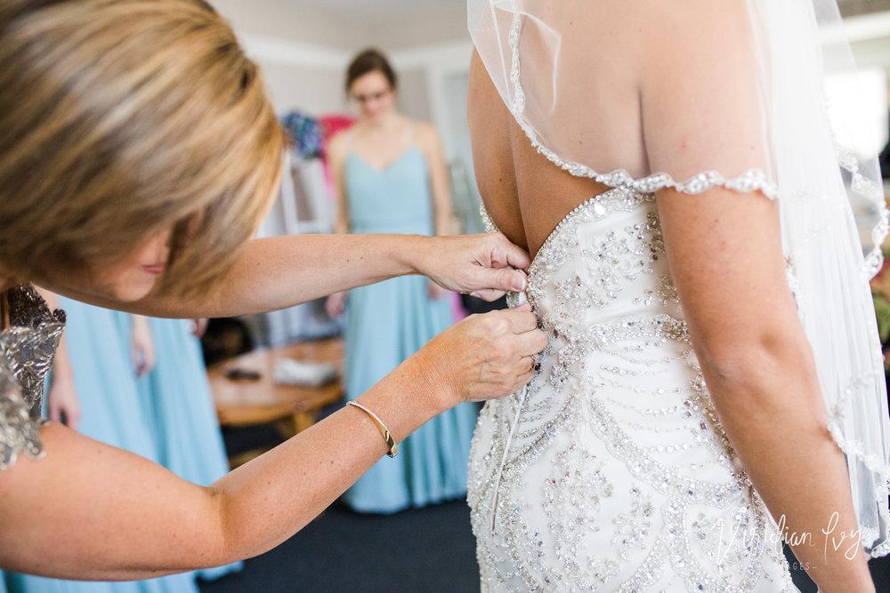 Mom zipping the dress.