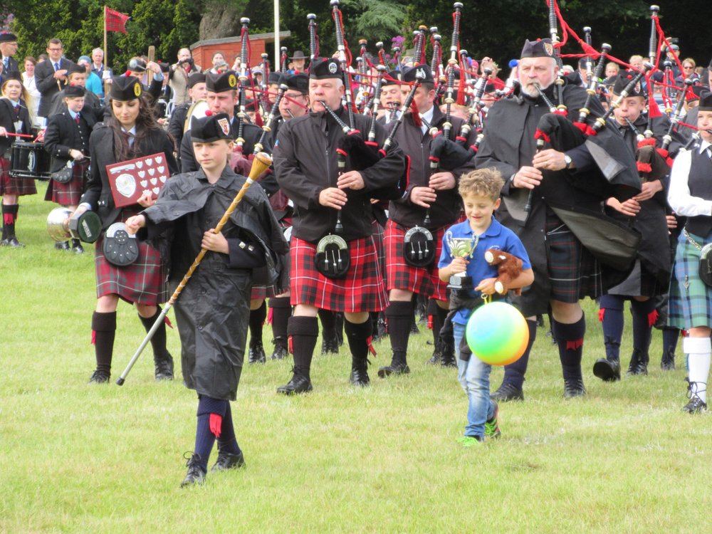 The combined pipe bands marching during closing ceremony of the Strathmore Highland Games