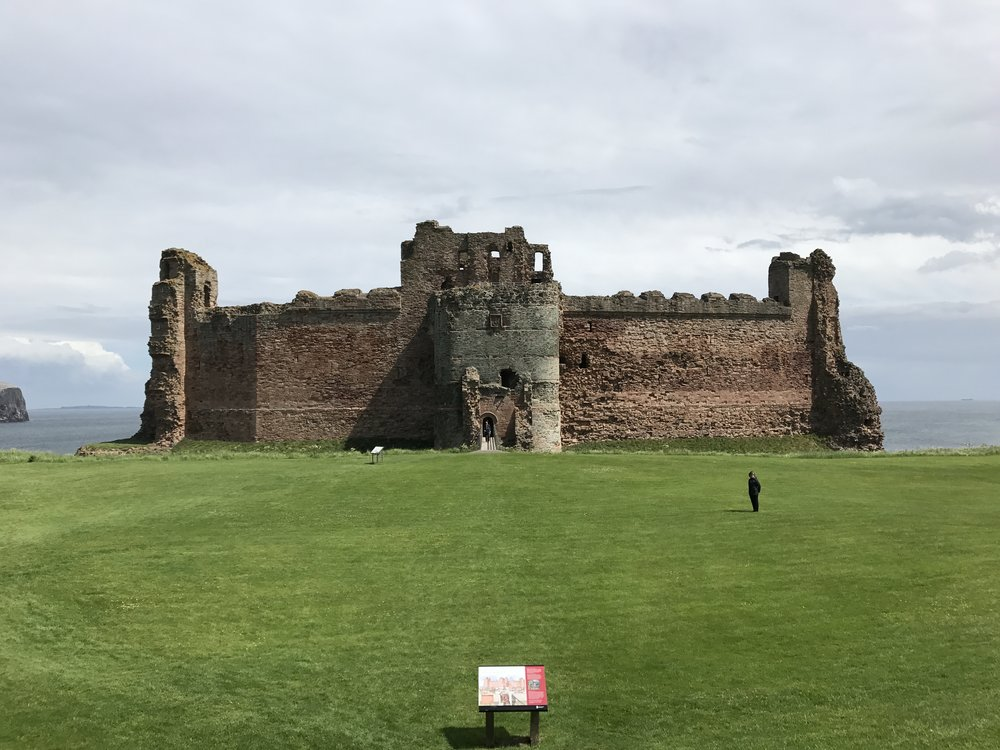 Jennifer strolling foregrounds of Tantallon Castle (1300's)