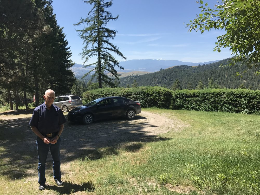 Professor Albert Borgmann in front of his mountain-top home in Missoula.