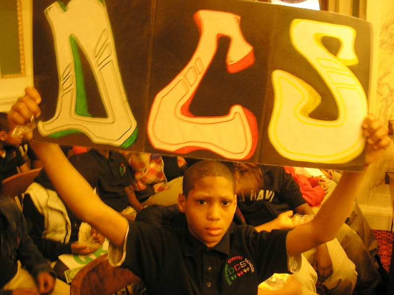 A Discovery Charter School student shows his support