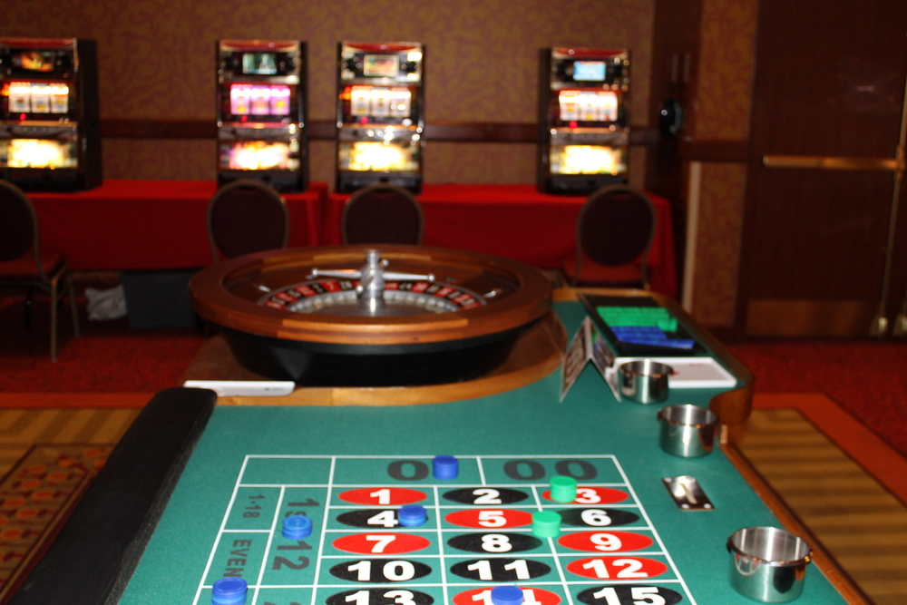 Corporate event showing roulette and slot machines