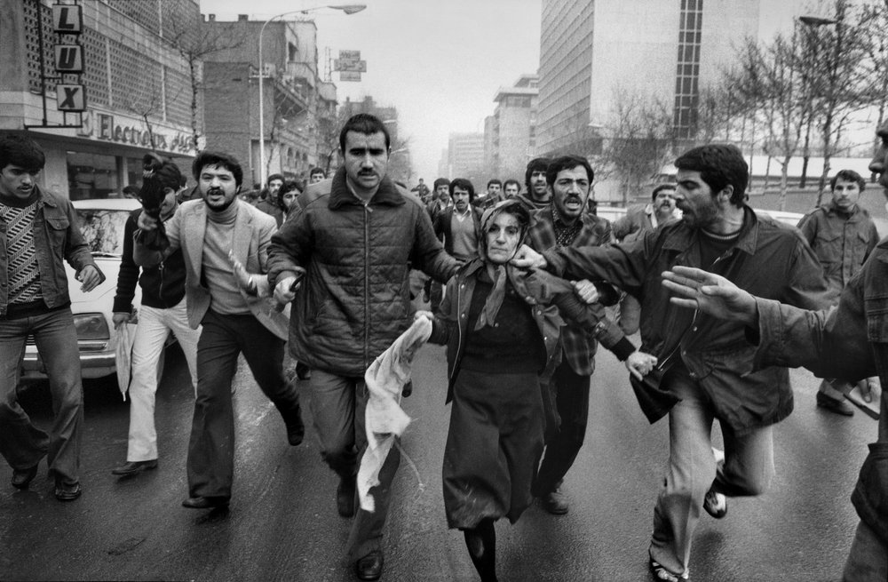 Revolutionaries beat up a supporter of the Shah, Tehran, January 25, 1979