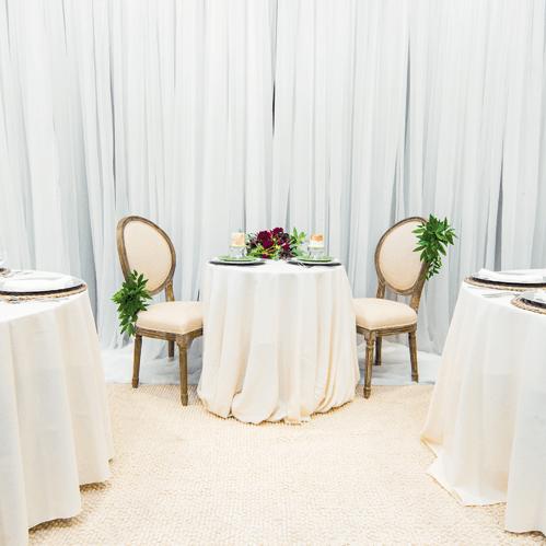 www-uptown-event-rentals-dot-com-34-sheer+ivory+linen+chair+decor+lg.png