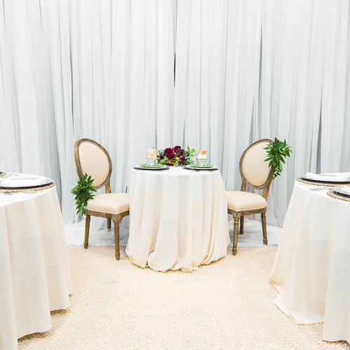 www-uptown-event-rentals-dot-com-34-sheer+ivory+linen+chair+decor+lg.png