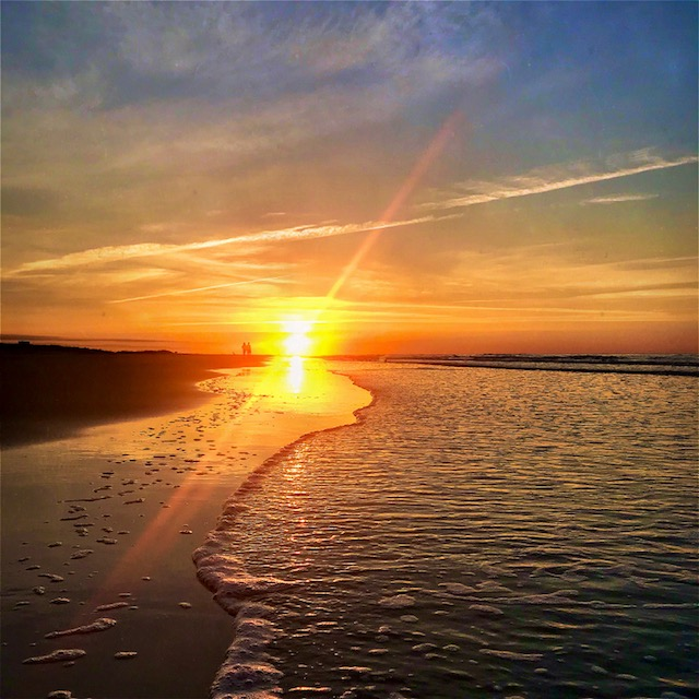 Greet the day with a sunrise walk on the beach