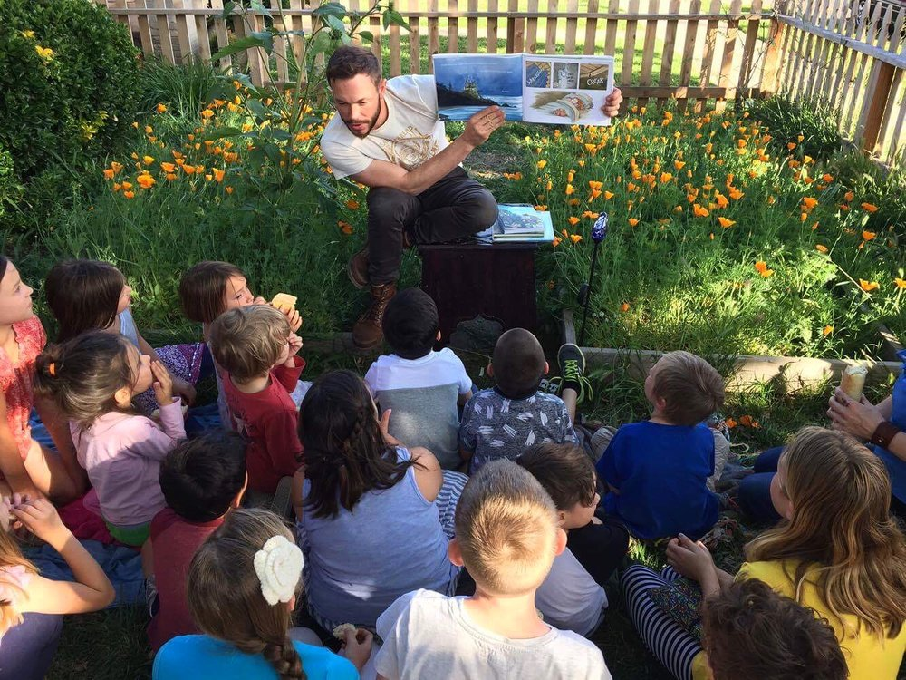 Guest, author and illustrator Ben Hatke, doing storytime at Alchemy Bread's friendship bake.