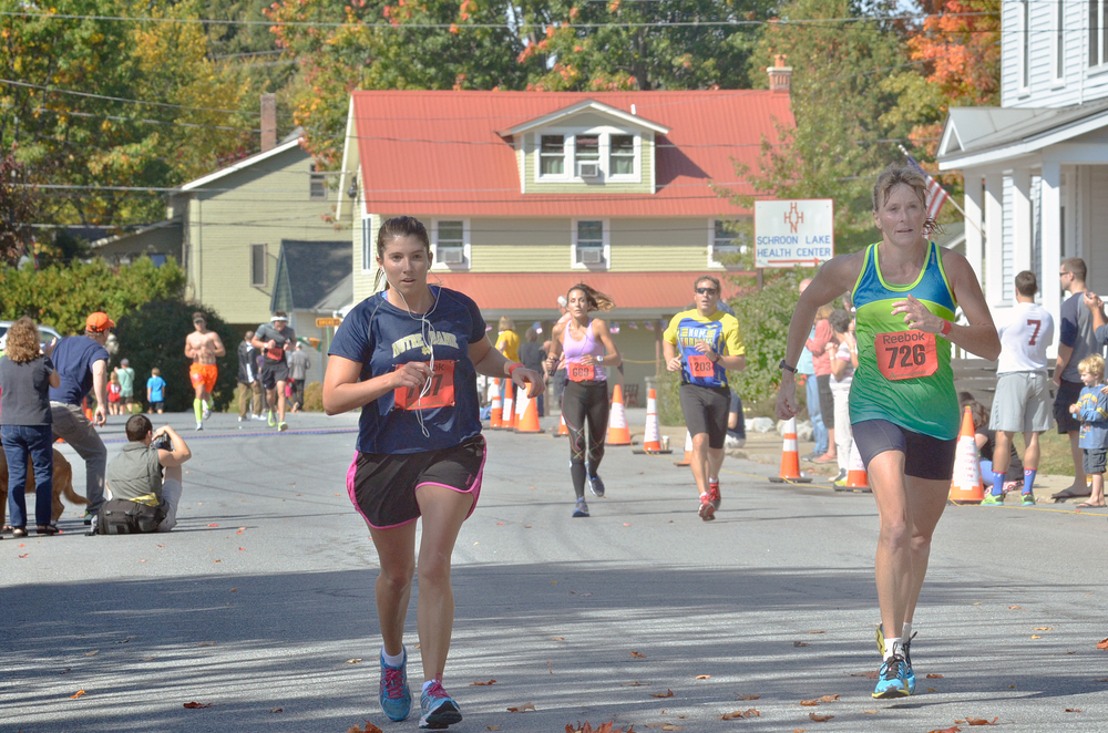 Finishing the 2014 Adirondack Marathon Distance Festival. © Pat Hendrick Photography/Event Photo Services