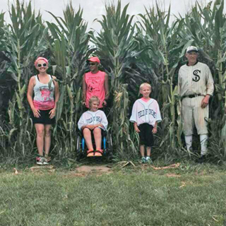"""Go the distance!"" Evans family at ""Field of Dreams"" movie site in Dryersville, Iowa."