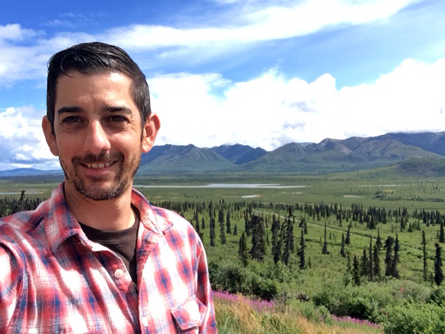 Buccinna poses along the Alaska Highway, where he took a six week solo trip this past summer.
