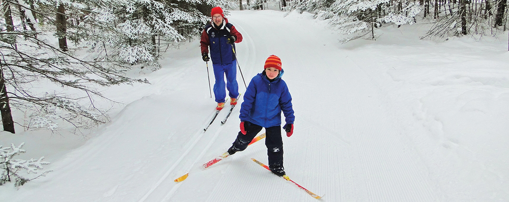 Martin Vysohlid skiing with his daughter on the Joki Latu trail at Lapland Lake.   Lapland Lake