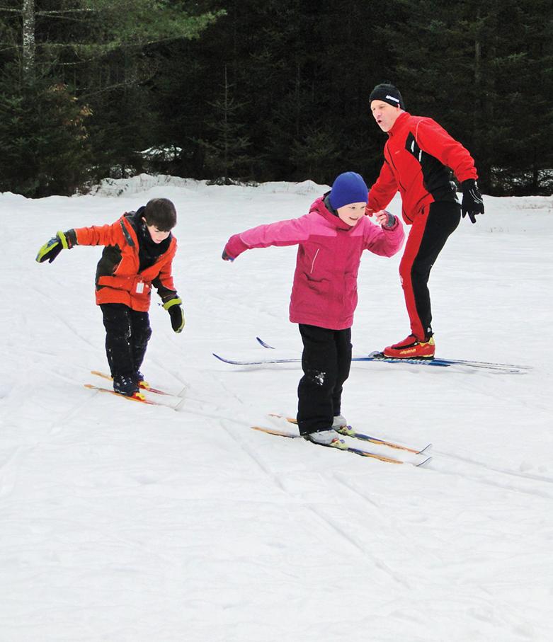 Instructor Pat Ferri teaching two kids at Lapland Lake. Lapland Lake