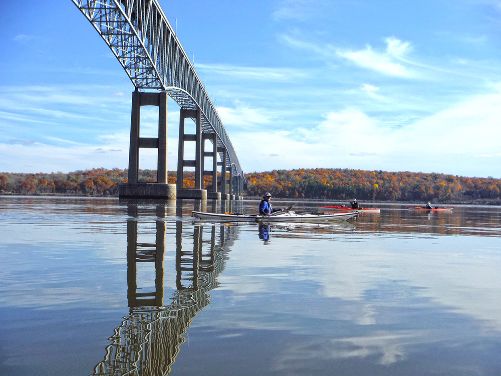 Kayakers pass under the Kingston-Rhinecliff Bridge on the Hudson River.    Rich Macha