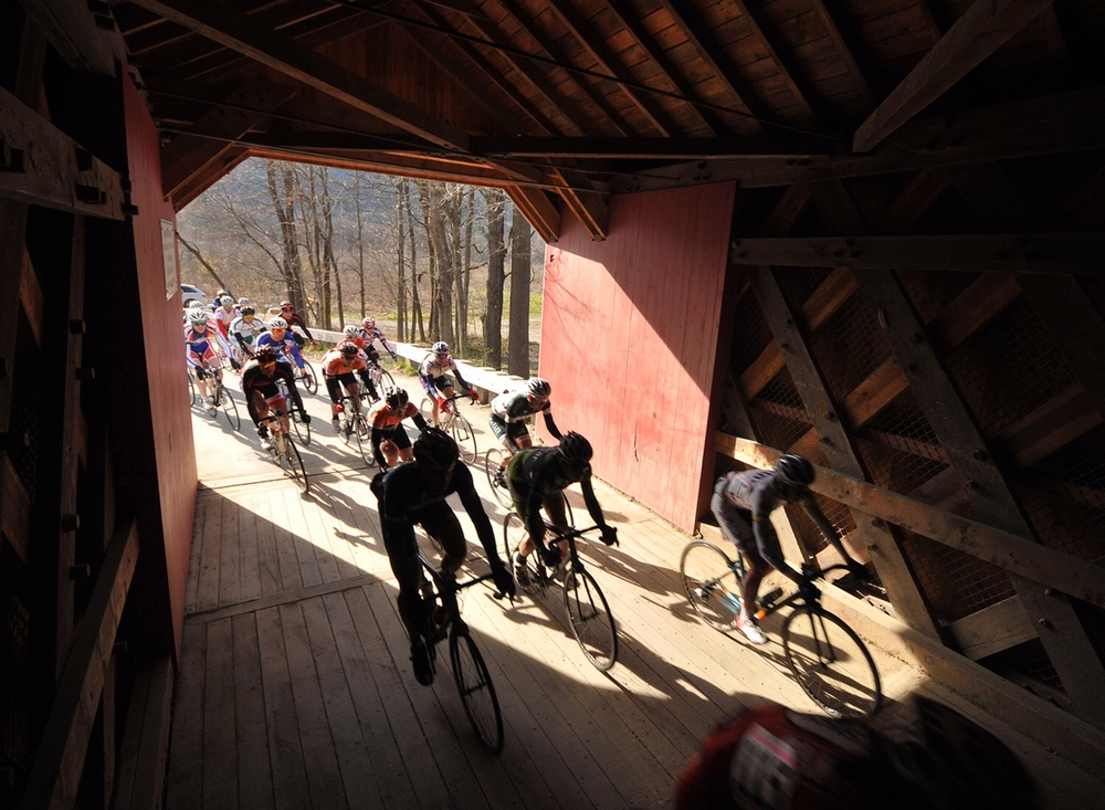 Riders head into the Eagleville covered bridge just after turning off of Rt. 113 east of Cambridge.  2012 - © Dave Kraus