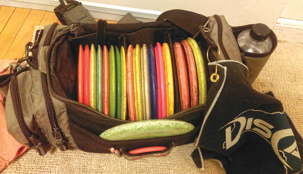 "A typical disc golfers bag will include drivers, midranges and putters. Each fly different distances, speeds and lines to allow options to get from tee to basket. Golfers often carry 10-20 discs in varying stabilities: ""understable"" discs go right, stable discs go straight, and ""overstable"" discs go left from a right-handed backhand throw."