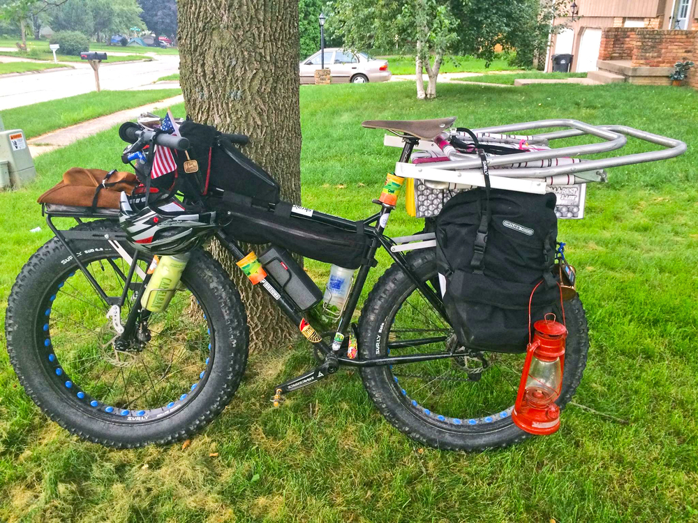 Everything but the kitchen sink on Shawne's fat bike at RAGBRAI in Iowa.  Janay Camp