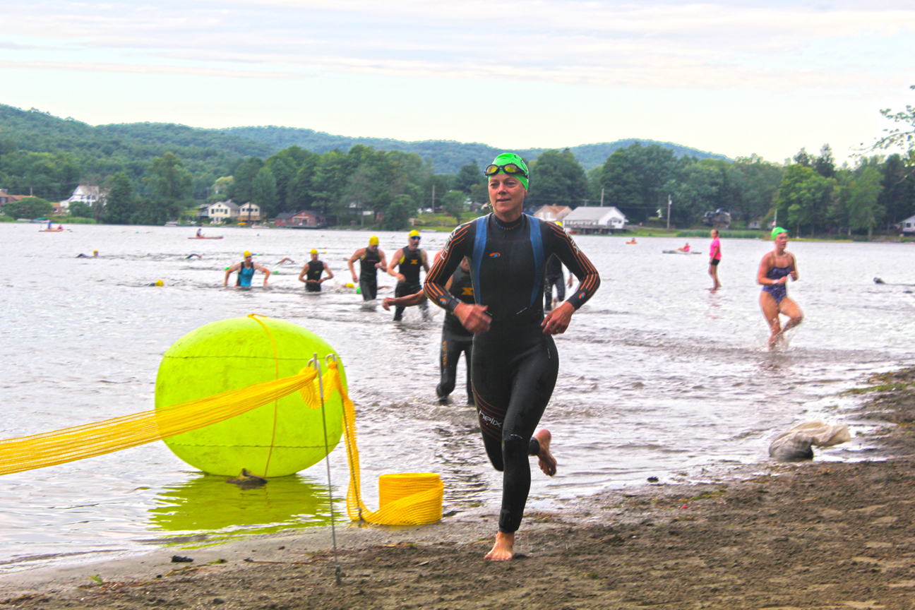 Swimmers exiting lake lauderdale at the 2015 Fronhofer tool Triathlon. Bridget Crossman