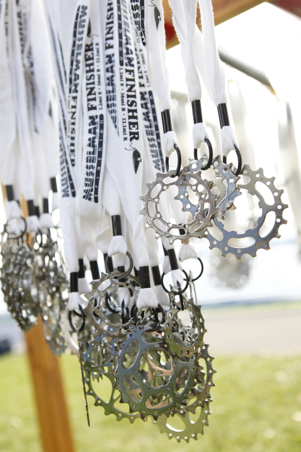 Since 2009, Musselman Triathlon has awarded finisher medals crafted from used bicycle cogs, a more sustainable choice than traditional race medals. Musselman Triathlon