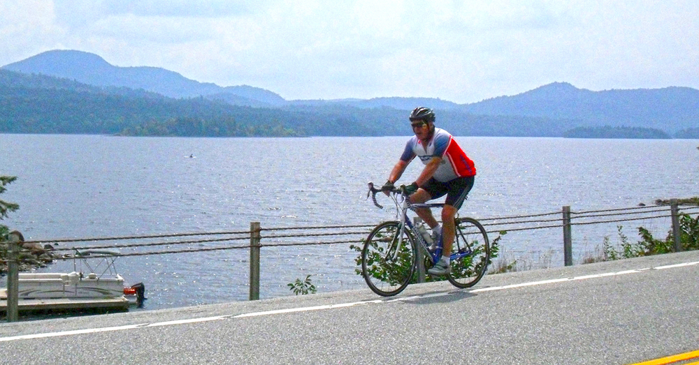 Rider heads north on Rt. 30 with Indian Lake in the background at the 2011 Ididaride.    © Dave Kraus