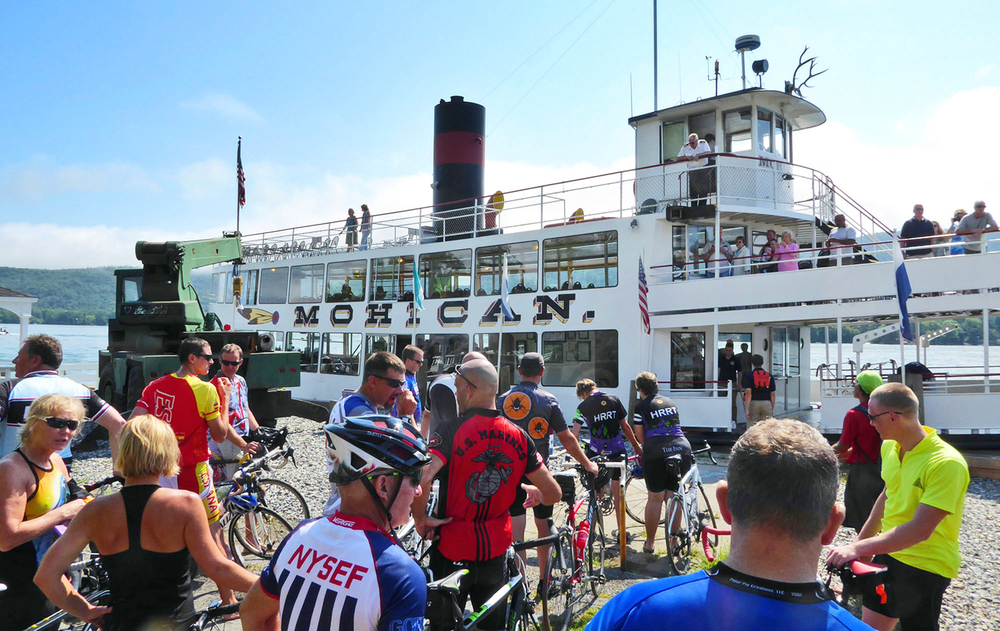 Riders wait to board the Mohican at the Ticonderoga town dock for the 2015 Ti Ride.  © Dave Kraus