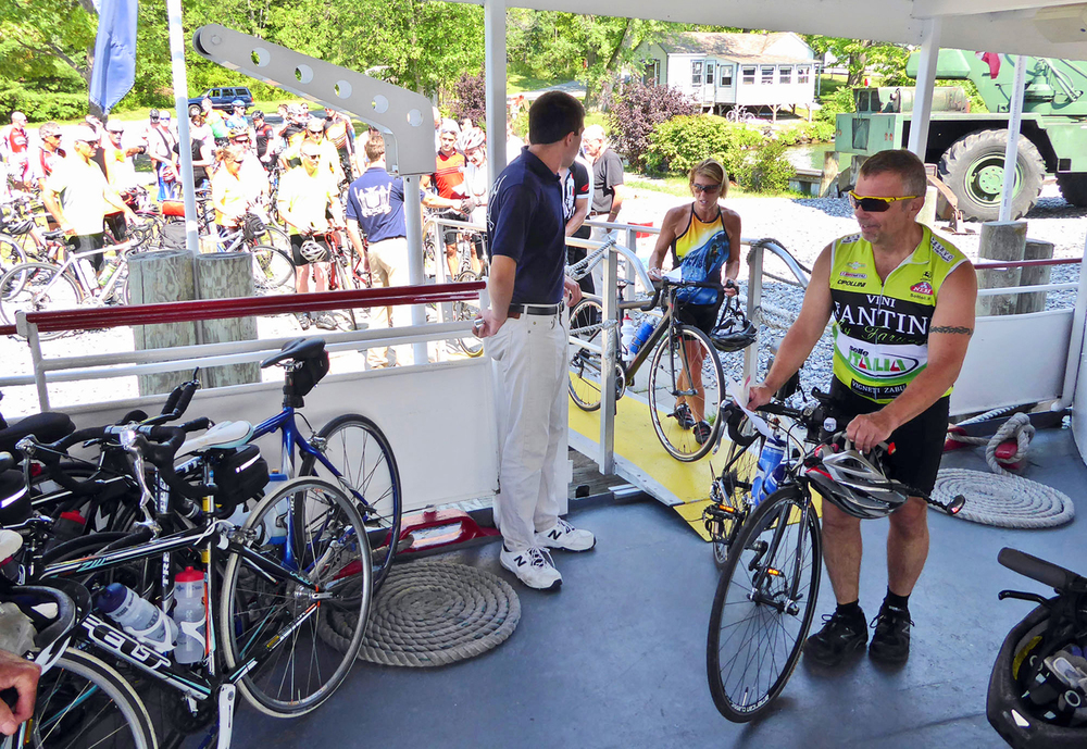 Riders wheel their bikes right onto the foredeck of the Mohican at the 2015 Ti Ride.  © Dave Kraus