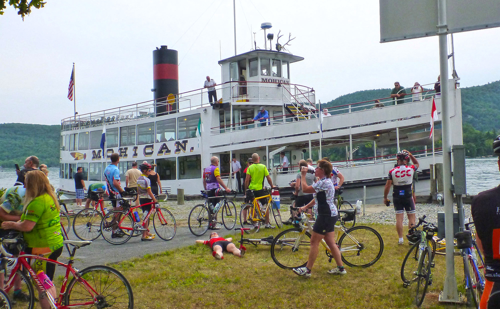 Riders welcome the Mohican to the Ticonderoga town dock at the 2013 Ti Ride.    © Dave Kraus