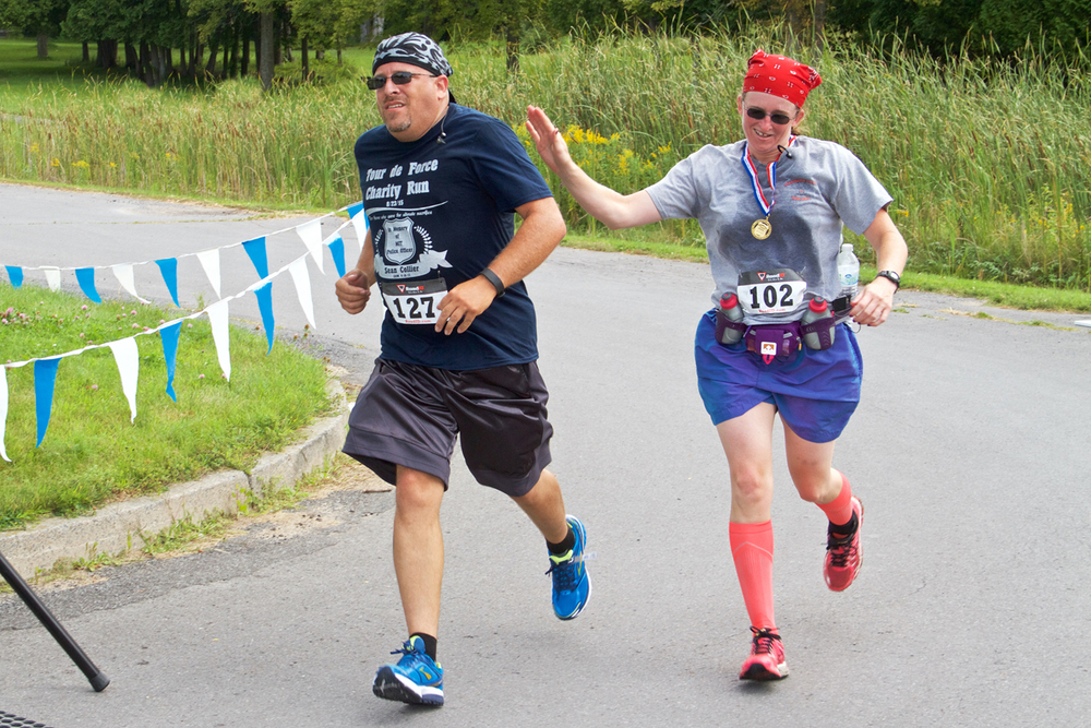 Maurice Martineau II and Nicole Agoney running in the 2015 Tour de Force 10K.   Howard Jennings