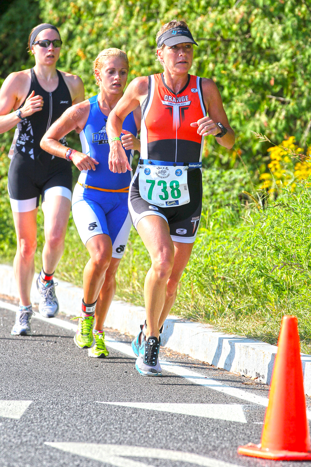 Runners power along during the Lake George Triathlon in 2015.   © Pat Hendrick Photography