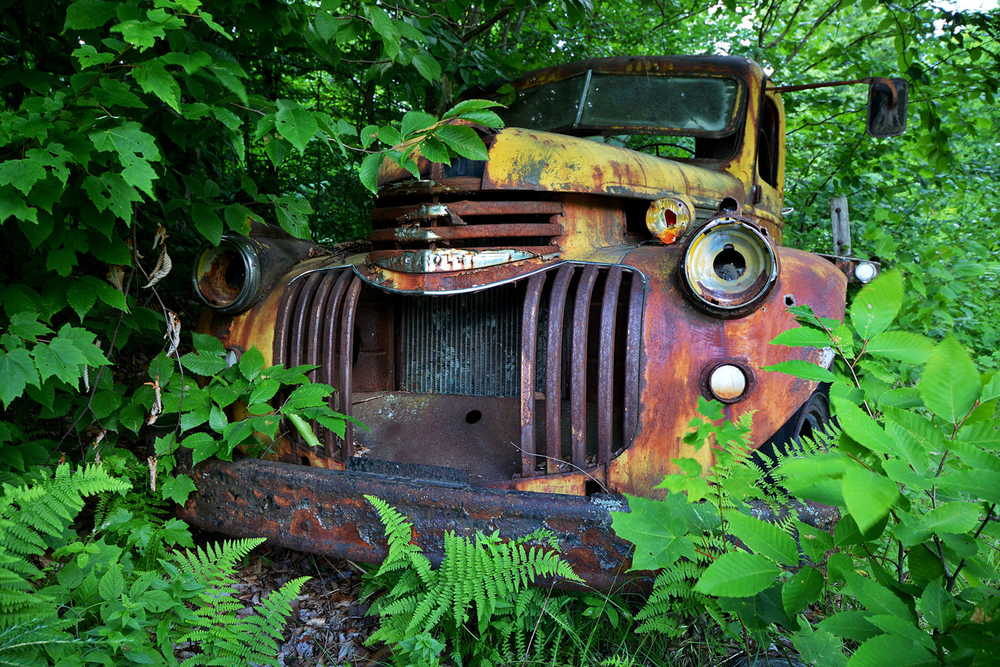 Some relics of the logging operations remain, at Essex Chain Lakes, such as the abandoned flatbed truck at the Deer Pond Parking area.  © Dave Kraus/ Krausgrafik.com