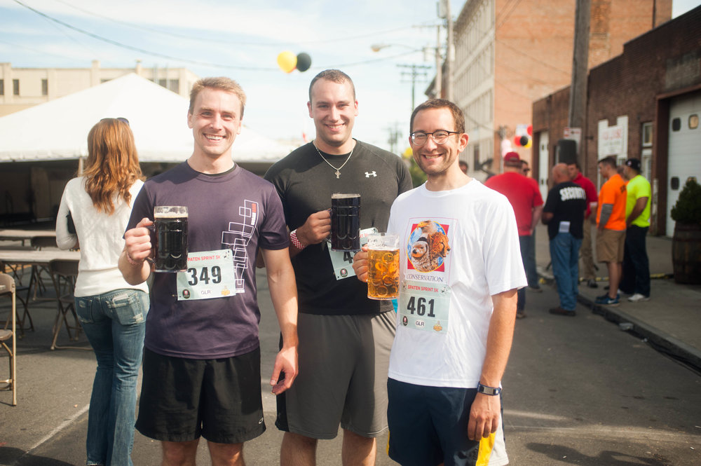 Runners enjoying their post race beer at last year's Oktoberfest Albany 5K.   Allison Bradley