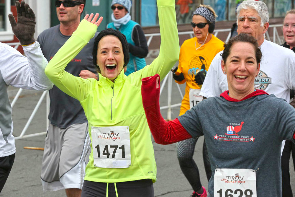 Runners celebrate the 2015 Troy Turkey Trot. Pat Hendrick Photography