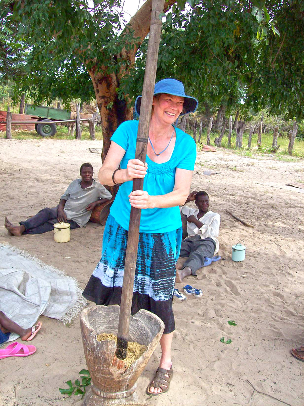 Virginia grinding grain for To Love A child in Zimbabwe.