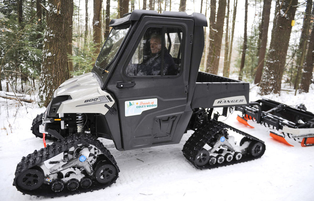 Volunteer Bill Parks has groomed Cole's Woods for 50 years; shown here with new utility vehicle and groomer in December 2014.   Megan Farmer/ www.poststar.com