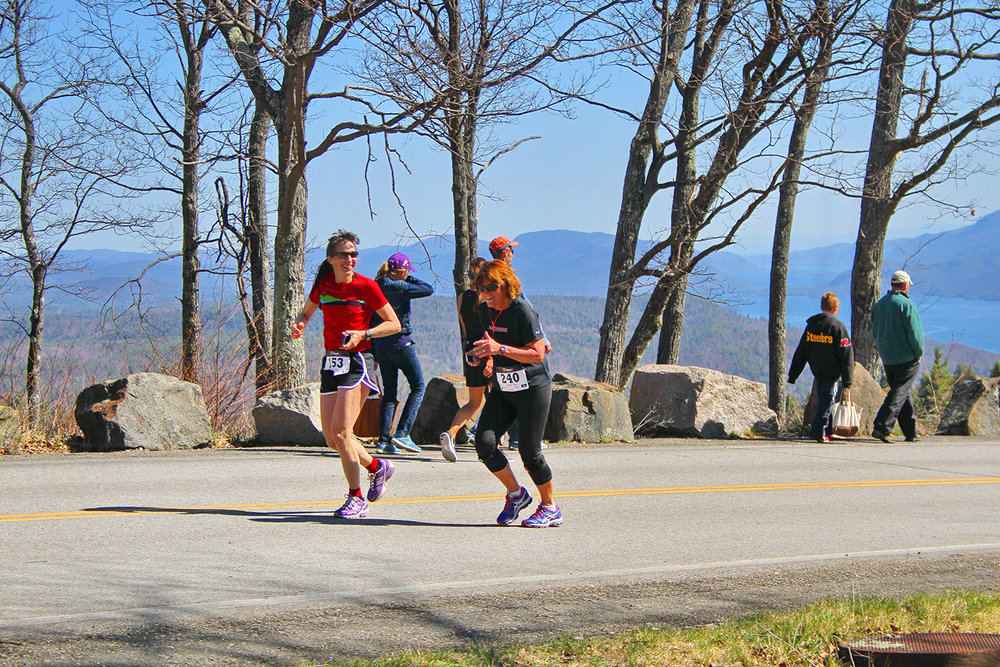 Finisher Christine Cifone-Clohosey cheers on Jill Pederson, race directors, at the 2016 Prospect Mountain Road Race.   Brian Teague/Fateague Photography