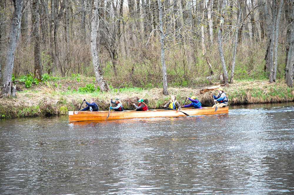 Mentoring youth in a voyager canoe.