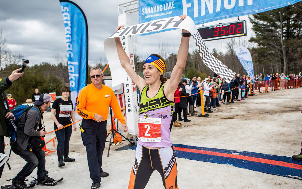 ■ Female champion, Ragna Debats of the Netherlands, crosses the line.   Photos Courtesy of Saranac Lake ADK