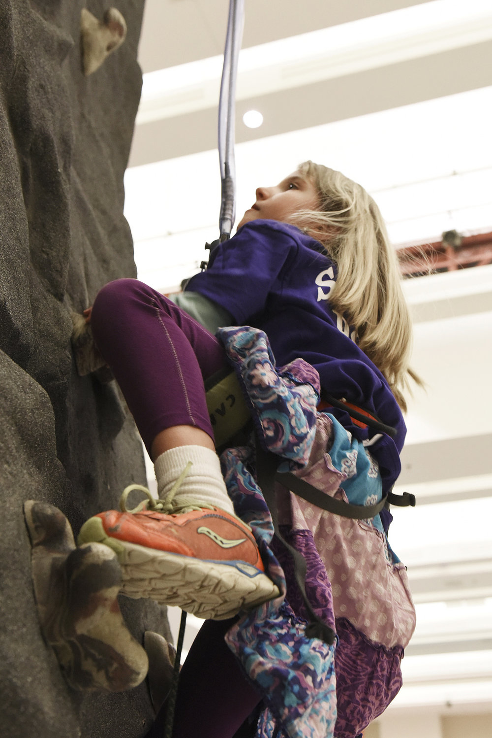 ERICA MILLER / GAZETTE PHOTOGRAPHER  Emily Cetnar, 7-years-old of Scotia, climbs the rock climbing wall at Damien Rock Wall booth during the Adirondack Sports Summer Expo at the Saratoga Springs City Center on Saturday afternoon, March 18, 2017.