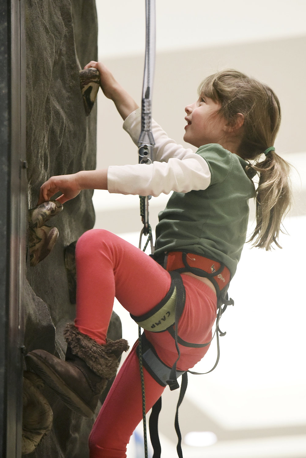 ERICA MILLER / GAZETTE PHOTOGRAPHER  Victoria Tastensen, 6-years-old of Wilton, climbs the rock climbing wall at Damien Rock Wall booth during the Adirondack Sports Summer Expo at the Saratoga Springs City Center on Saturday afternoon, March 18, 2017.