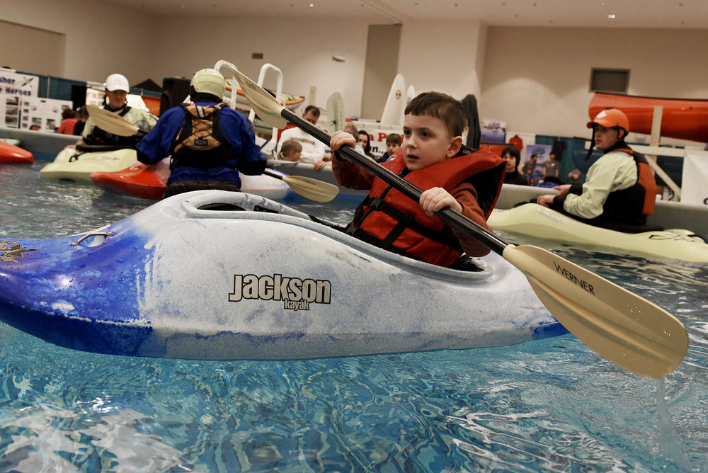 ERICA MILLER / GAZETTE PHOTOGRAPHER  Jackson Cowell, 5-years-old of Mechanicville, learns to kayak in a indoor pool set-up during the Adirondack Sports Summer Expo at the Saratoga Springs City Center on Saturday afternoon, March 18, 2017.