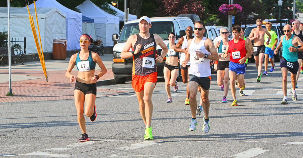 ● Runners start the Adirondack Distance Run 10 Miler in Lake George.   Brian Teague/Fateague Fotos